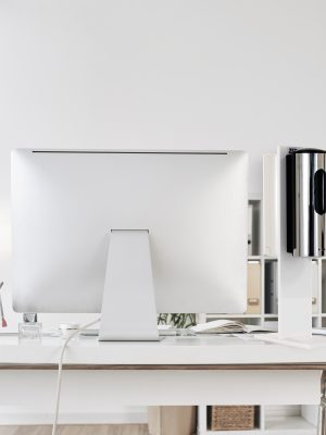 Nobody at office table with big computer monitor